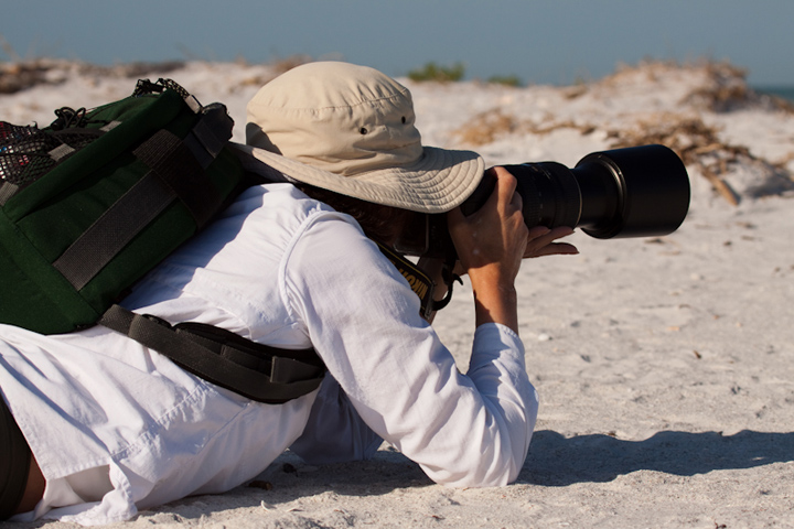 Mia McPherson photographing shorebirds