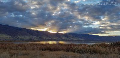 Cloudy sunrise over the Wasatch Mountains, Farmington Bay WMA, Davis County, Utah